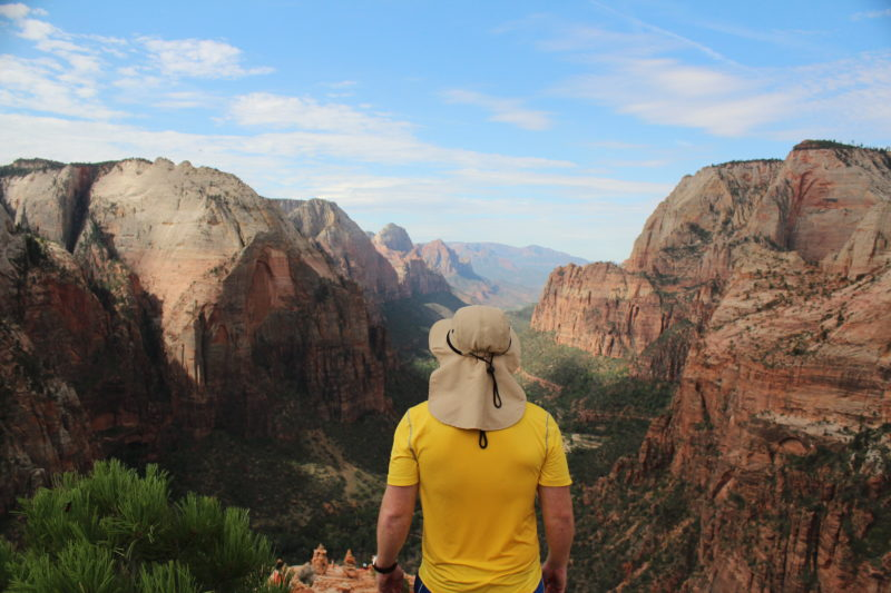 A hiker soaks in the views at Zion National Park.